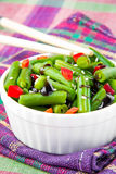 Green beans in white cup with chopsticks Stock Photography