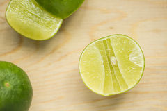 Green lemon. With detail of inside Stock Photography
