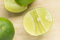 Green lemon. With detail of inside Royalty Free Stock Images