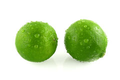Green lemon with droplets Stock Images