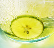 Green lemon with ice tea - bright colors Stock Photo