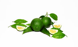 Green lemon with lemon slices. Green lime slices with lemon slices and leaves isolated stock photography