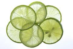 Green lemon slices thin pattern circle lighting. stock photo