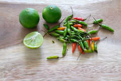 Green limes and spicy chili Royalty Free Stock Images