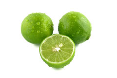 Green lemon with water droplets. Green lemon on droplets of water Stock Images