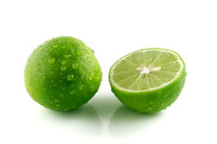 Green lemon with water droplets. Green lemon cut on droplets Stock Photo
