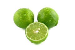 Green lemon with water droplets. Fresh green lemon with water droplets Royalty Free Stock Photography