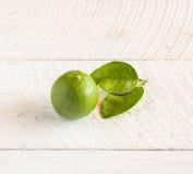 Green lemon on wood background Stock Photo