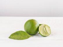 Green lemon on wood background Stock Photos