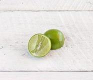 Green lemon on wood background Stock Images