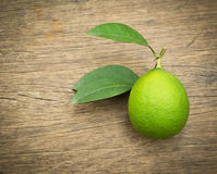 Green lemon on the wooden background Royalty Free Stock Photography
