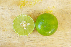 Green lemon on the wooden table Stock Images