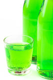 Green drink in bottle and small glass Stock Photos