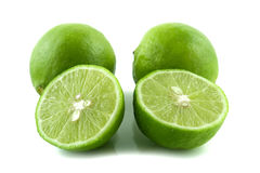 Green lemons. Fresh green lemons on white background Royalty Free Stock Images