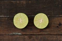 Green lemons. From the garden on wooden Stock Photo