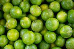 Green-Lemons. In the market Royalty Free Stock Image