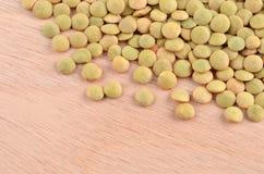 Green lentil on wooden background Stock Images