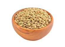 Green lentil in wooden bowl Royalty Free Stock Photo