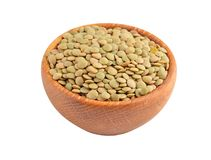 Green lentil in wooden bowl Royalty Free Stock Image