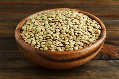 Green lentil in a wooden bowl Royalty Free Stock Photography