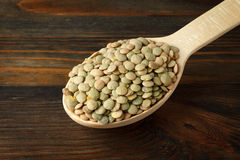 Green lentil in a wooden spoon Royalty Free Stock Images