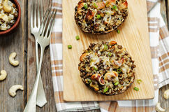 Green lentils, brown rice, cashew stuffed portobello stock images