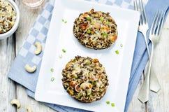 Green lentils, brown rice, cashew stuffed portobello Royalty Free Stock Photo