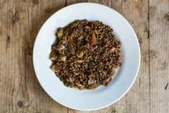 Green lentils with vegetables and bacon, on plate from above Royalty Free Stock Photography