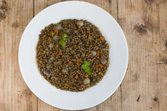 Green lentils with vegetables, on plate from above Stock Image
