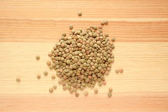 Green lentils on wood Royalty Free Stock Photos