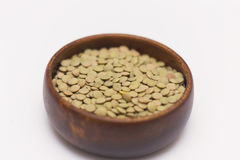 Green lentils on wooden bowl Royalty Free Stock Photo