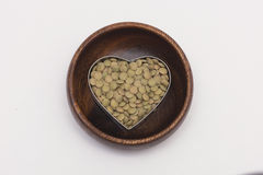 Green lentils on wooden bowl Royalty Free Stock Images