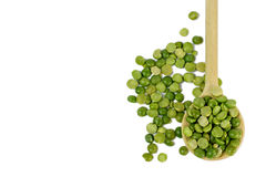 Green lentils in wooden spoon Stock Photography
