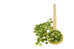 Green lentils in wooden spoon  on white Stock Photography