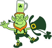 Green Leprechaun Balancing with a Glass of Beer over his Head Royalty Free Stock Images