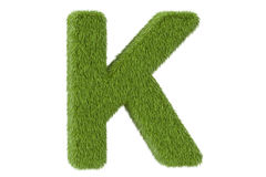 Green letter K from grass closeup, 3D rendering Royalty Free Stock Photography