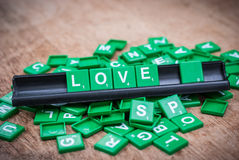 Green letter of scrabble game Royalty Free Stock Photos