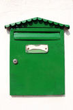 Green letterbox. Closeup of green letterbox on white wall Stock Photos