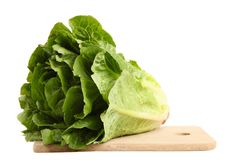 Green lettuce romaine. On a cutting board isolated on white background royalty free stock photos