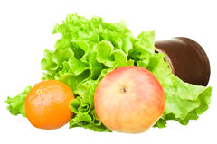 Green lettuce salad with a mandarin and apple Stock Photos