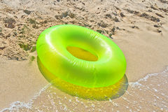 Green life buoy on beach Stock Image