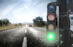 Green light. View of a traffic light on a countryside road Stock Photos
