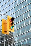 Green Light. Traffic Light flashes go; urban building in background Royalty Free Stock Photo
