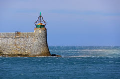 Green light beacon harbor Stock Photography