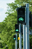 Green light for bicycles. Three green traffic lights for bicycles in a row Royalty Free Stock Photos
