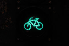 Green light for bikers by night Royalty Free Stock Photos