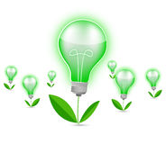 Green light bulb. With green leaves Stock Photography