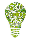 Green light bulb with environmental icons Stock Photography