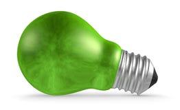 Green light bulb lying  on white Royalty Free Stock Images