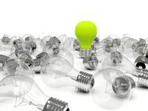 Green light bulb in a pile of bulbs Stock Photo